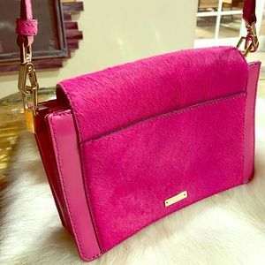 Kate Spade hot pink leather and fur crossbody bag.